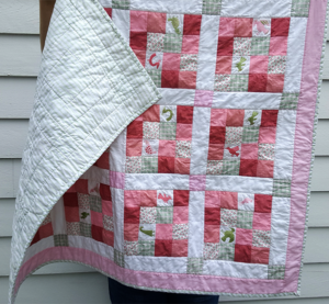 image of pink and green bird quilt