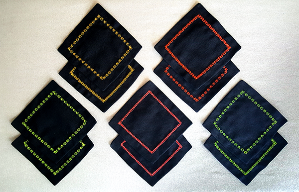 image of black coasters with neon hemstitch borders